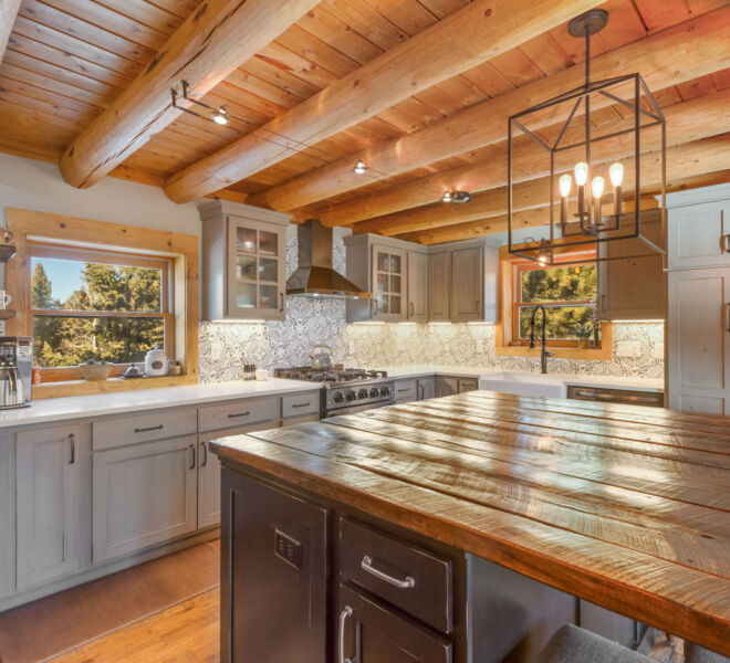 Spacious log home kitchen with intricate functional details